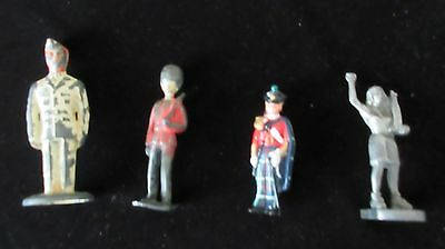 Four Vintage Lead Figures, Three Soldier & One Bowling