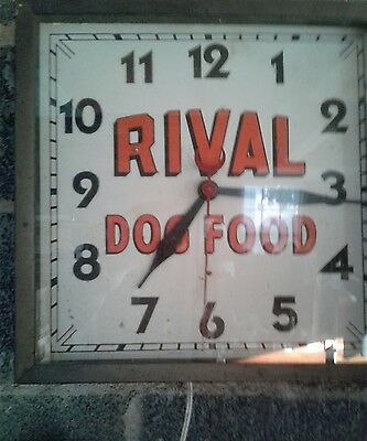 VINTAGE ANTIQUE 1940 S RIVAL DOG FOOD ADVERTISING CLOCK works