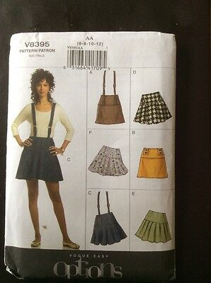 VERY EASY VOGUE PATTERN V8395. New, Uncut. Mini skirt with braces.
