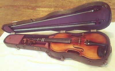 vintage 4/4 violin in nice clean condition.  labeled. Nice clean case