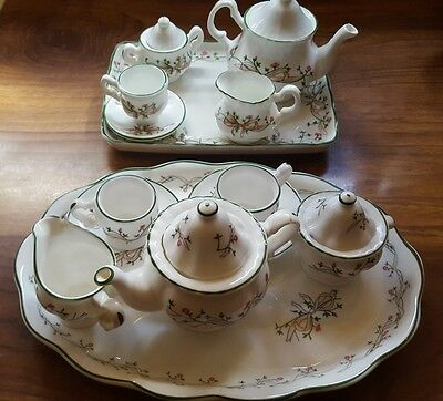 2 x beautiful print miniature tea set. Both damaged. Can mix to use as one