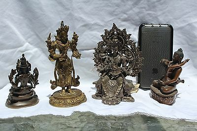 Group of 4 bronze statues