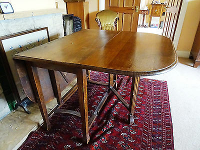 solid oak dining table with drop flaps