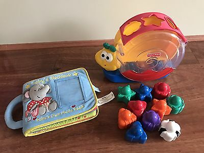 Fisher Price Musical Rocking Snail Shape Sorter And Soft Book Educational Toy