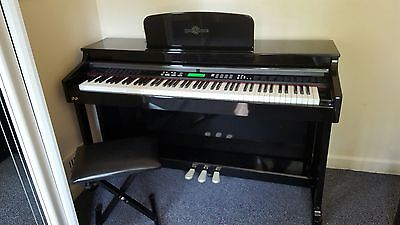 Black digital piano with stool in great condition
