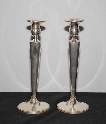 PAIR OF FISHER WEIGHTED STERLING CANDLESTICKS. Lot 206