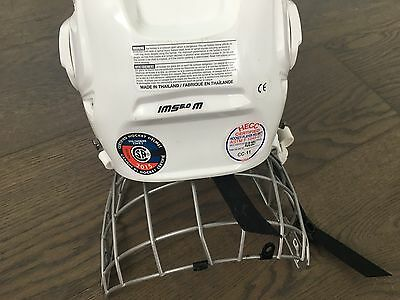New white Bauer hockey helmet with clear visor, full facemask size Medium