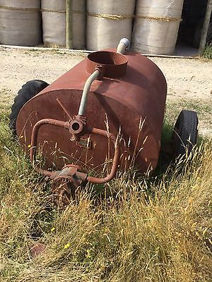 Vintage Water Carrier With Diamond T Wheels