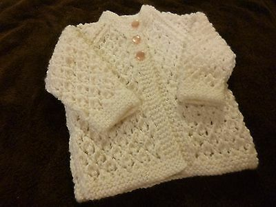 WHITE BABY JACKET  Hand Knitted.  6 months  Lace Pattern  Buttons your choice