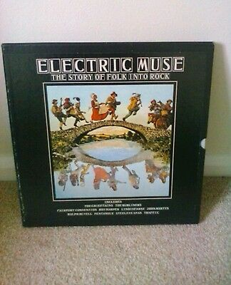 Electric Muse The story of folk into rock . Set of 4 LP records and booklet .