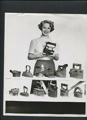LOVELY MONA FREEMAN WITH COLLECTION OF ANTIQUE IRONS - 1940s VINTAGE