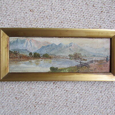 antique oil painting of a mountainous scene and lake, framed and signed
