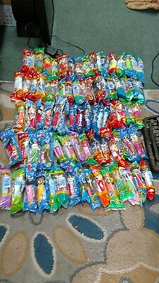 PEZ Lot of 100 items Mickey 80 year set and a bunch of sealed & loose characters