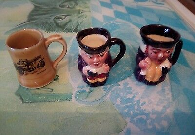 two small toby jugs and a wade mini cup