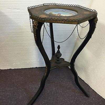 French Empire inlaid tripod stand with inlaid devil heads sgd. center plate