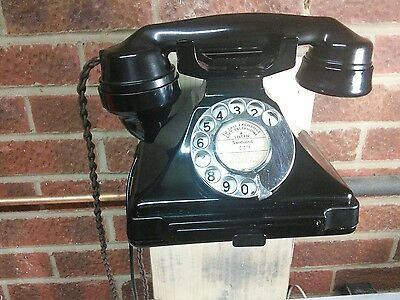 Vintage 232 pyramid phone with wall mount.