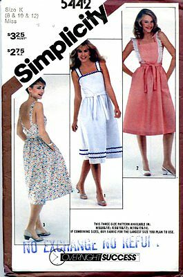 Uncut Sewing Pattern Ladies Wrap Dress with low V Back Size 8-12. Date 1982