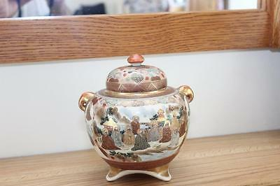 A Japanese Satsuma Koro Decorated With Figures, Elephant Handles & Domed Cover