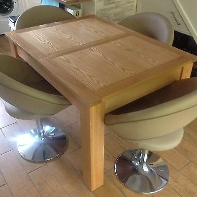 oak dining table with four dwell chrome based chairs Extendable Table