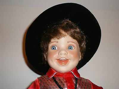 Adorable Porcelain Boy Doll wearing a cowboy outfit