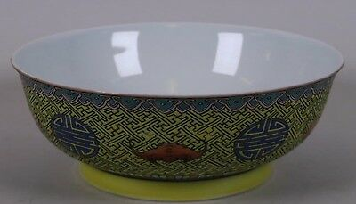 A Chinese famille jaune enamelled porcelain rice bowl