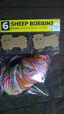 Knitting Sheep Bobbins And Yarn