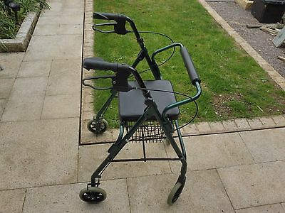 Mobility walker with seat and shopping basket, swivel wheels