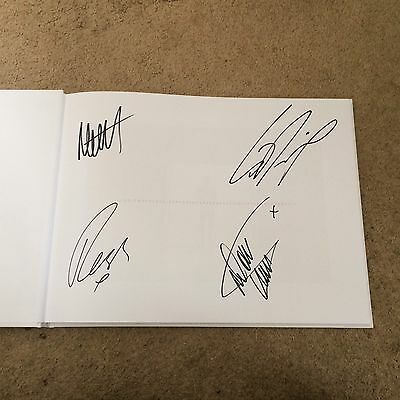 The 1975s Rare Signed Photo Book