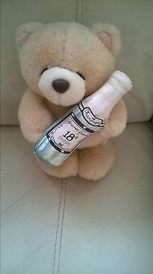 Forever Friends plush teddy bear holding a 18th birthday champagne bottle