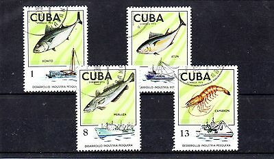 set of 4 used fish and fishing boat themed stamps