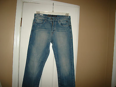 Lot of 6 Pieces of Men and Women Clothing: Over $2400.00 Retail Value.