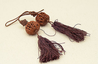 Two Chinese carved carving walnuts / pits / heidao nuts