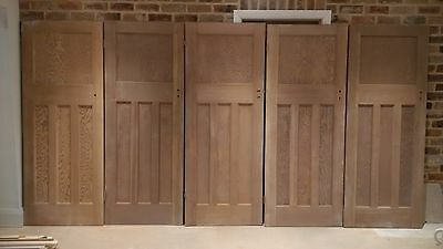 Reclaimed 1930's 1 over 3 paneled pitch pine doors.  (5 available)