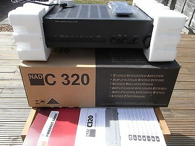 NAD C320 Stereo Integrated Amplifier with remote, manuals and original boxes