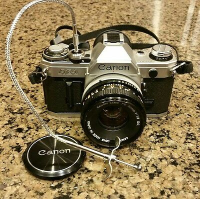 VINTAGE CANON AE-1 35mm SLR FILM CAMERA WITH FD 50mm LENS