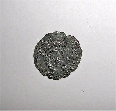 Ancient Roman Empire, Provincial 100-400 AD. Bronze coin. Crescent with stars