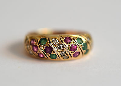 Fine 18ct gold diamond, emerald and ruby multi gem stacking ring