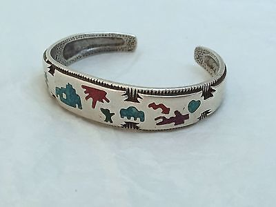 Southwestern Sterling silver Navajo style turquoise inlay storyteller bracelet