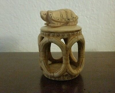 antique bovine bone carved netsuke  lucky turtle on round basket