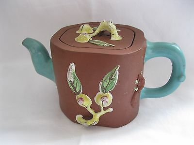 Chinese octagonal terracotta teapot with applied decoration. Marked