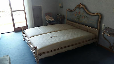 Beautiful antique bed with embroidered silk headboard