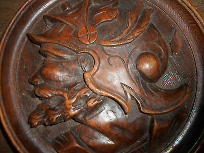 Superb 19thc Black Forest hand carved male head  on oak circular plaque.