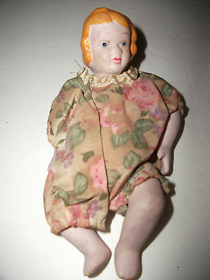 Bisque/porcelain Small Jointed Doll W/ Hand Painted Face