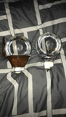 Two Original Early Antique  Glass Fire Grenades Along With Both Of Their Holders