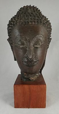 Thailand 15th-16th c. Bronze head of Buddha on a wood base. Approx. 9 5/8""