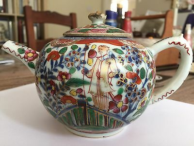 A Very Rare Kangxi Period Tea Pot With Hand painted Oriental figures.