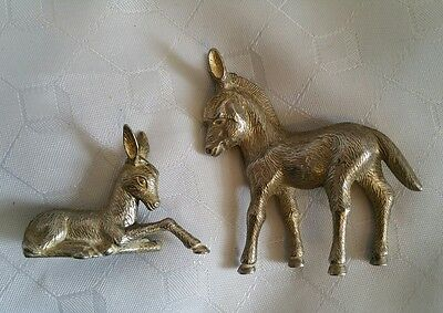 A pair of Vintage zebra or donkey silver plated figures mother and foal