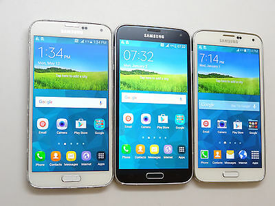 Lot of 3 Samsung Galaxy S5 T-Mobile SM-G900T Smartphones Power On AS-IS GSM!