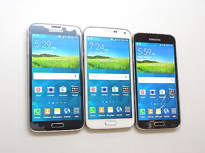 Lot of 3 Samsung Galaxy S5 T-Mobile Smartphones Power On AS-IS GSM #