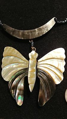 Mother of Pearl butterfly beaded necklace that is more dimensional than flat.
